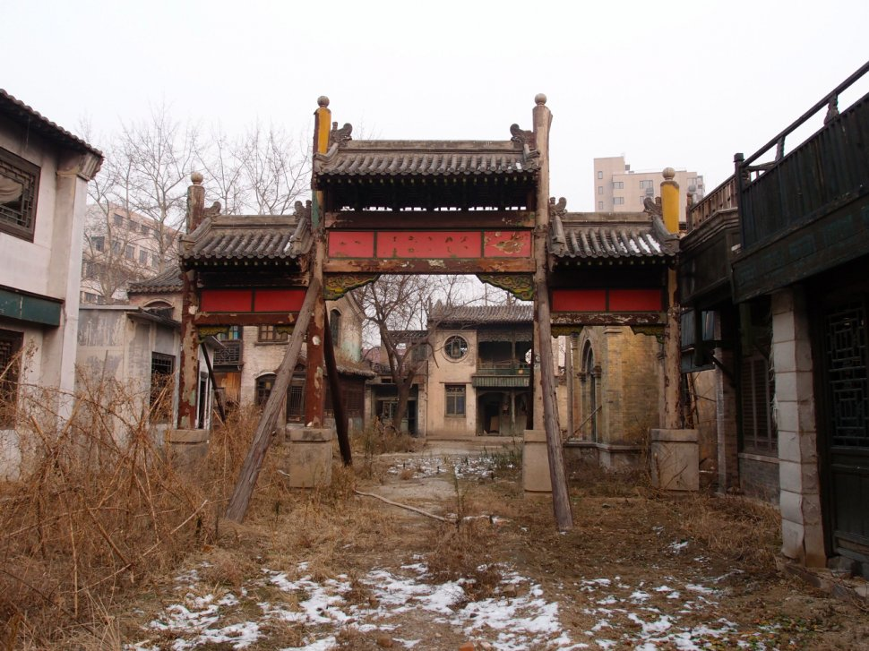 Photo 12. Certain buildings with long histories also stand neglected, such as these former films studios in Beijing, which date from the 1950s and have been abandoned since 2012 following a move to new premises on the outskirts of the city, with film sets awaiting demolition.