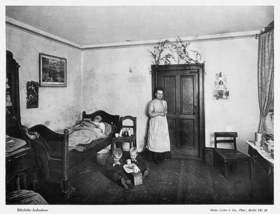 "The apartment comprises a living room, a bedroom, and a kitchen. It is reached by descending a staircase of 14 steps. The rooms are dark and damp. H. 2.50 m [8'2""], with the floor 1.50 m [4'11""] beneath street level. An image of poverty and distress. The man has eye and lung conditions; two children have recently died."