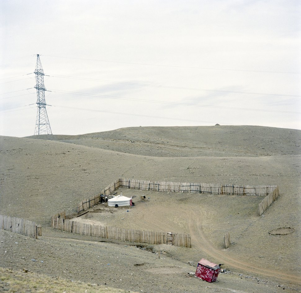 <p>The latest arrivals to the capital. Plots of land are distributed by the state: every citizen has the right to a plot of land of their choosing. If the plot is available, the family marks out its boundaries with wooden fencing.</p> <p>The end of the yurt neighbourhood, Uliastai, Ulan Bator, April 2011.</p>